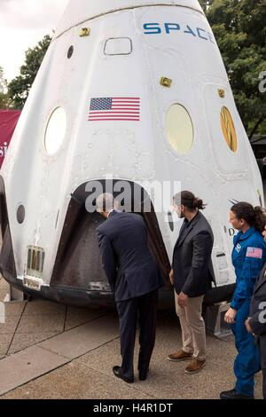 U.S President Barack Obama looks inside the Space X Dragon commercial crew capsule with Space X engineer Kiko Dontchev, - Stock Photo