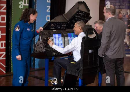 U.S President Barack Obama tries out a flight simulator during the the White House Frontiers Conference at Carnegie - Stock Photo