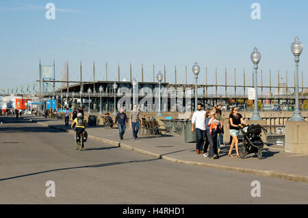 People on the Promenade des Artistes with Jacques Cartier Pavilion in back, Old Port of Montreal, Quebec, Canada - Stock Photo