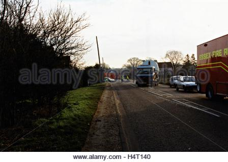 Car driver dies as truck topples - Stock Photo