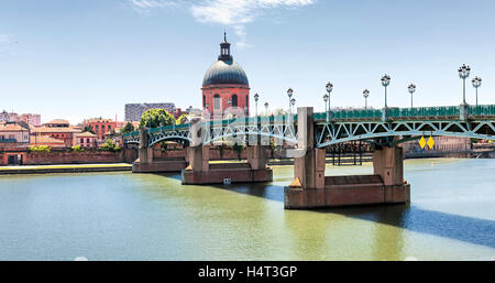 Panoramic view of Saint-Pierre Bridge over Garonne river and Dome de la Grave in Toulouse, France - Stock Photo