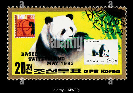 Postage stamp from North Korea depicting a panda bear and a Chinese stamp with the same subject. - Stock Photo