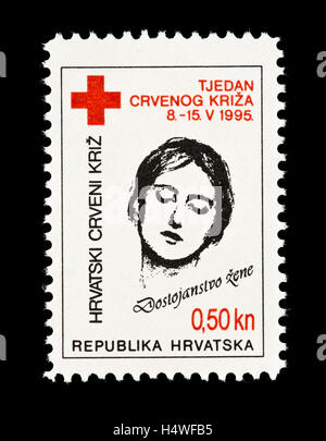 Postage stamp from Croatia depicting a woman, issued for the Red Cross. - Stock Photo