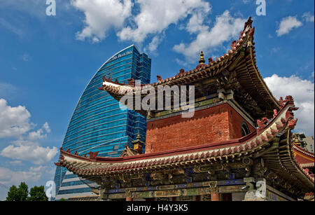 The modern hotel The Blue Sky and the traditional Choijin Lama Temple, Ulaanbaatar, Mongolia - Stock Photo