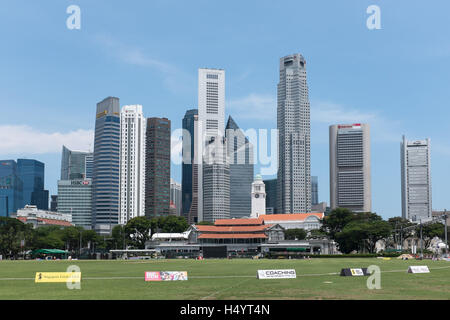 Singapore skyscrapers from central business district taken with historical cricket ground and club in foreground - Stock Photo