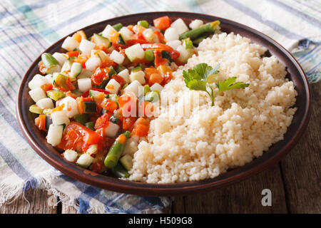 Couscous with vegetables and herbs closeup on the table. horizontal - Stock Photo