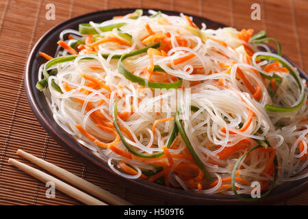 Asian crystal noodles with cucumber and carrot on a plate close-up. Horizontal - Stock Photo