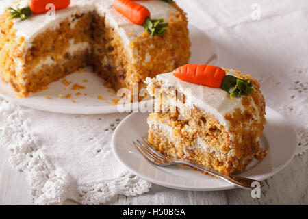 Homemade desserts: sliced carrot cake on a plate closeup. horizontal - Stock Photo