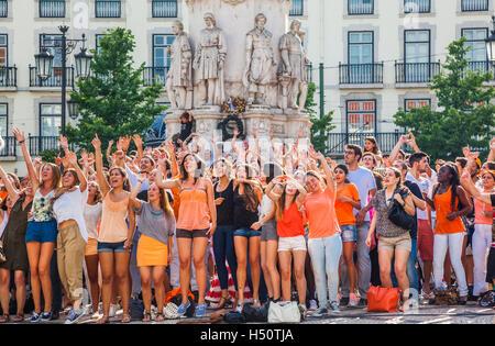 cheering crowd on Largo de Camoes, in the Lisbon neighborhood of Chiado, Lisbon, Portugal - Stock Photo