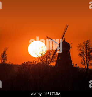 Silhouette of a old windmill at sunset. Skane / Scania, Sweden, Scandinavia. - Stock Photo