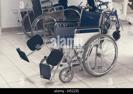 Empty wheelchair parked in hospital - Stock Photo