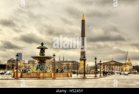 Place de la Concorde with Obelisk of Luxor and fountains - Paris - Stock Photo