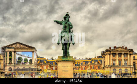 Statue of Louis XIV in front of the Palace of Versailles near Pa - Stock Photo