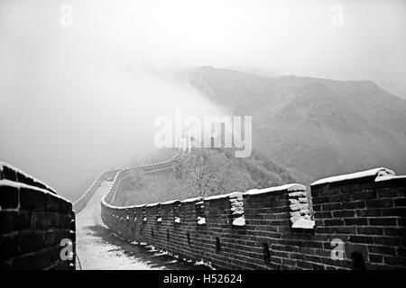 Part of the Mutianyu section of the Great wall of China under snow in winter at Mutianyu near Beijing China - Stock Photo