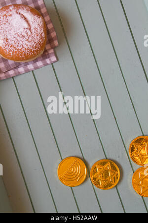 Flat Lay Jewish holiday hannukah symbols - donut and chockolate coins on vintage background,lot of copy space - Stock Photo