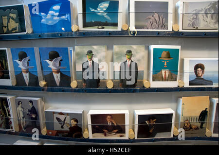 Greeting card reproductions of Rene Magritte paintings on display in gift shop at the  Royal Museum of Fine Arts - Stock Photo