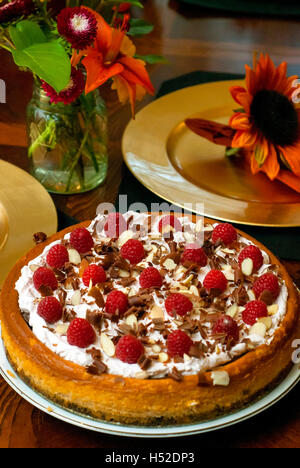 Raspberry chocolate cheesecake on a Fall table setting - Stock Photo