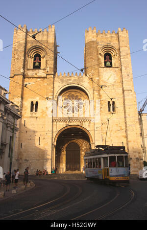 Tram passing Se Cathedral Alfama Lisbon Portugal - Stock Photo