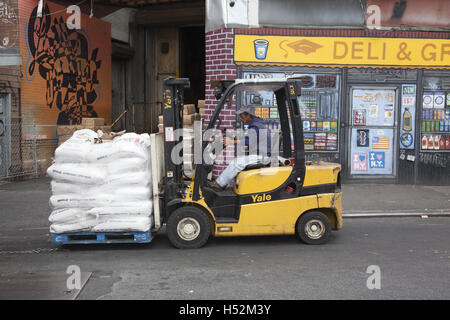 Forklift piled up with large sacks of rice in the Chinatown neighborhood on the Lower East Side of Manhattan. - Stock Photo