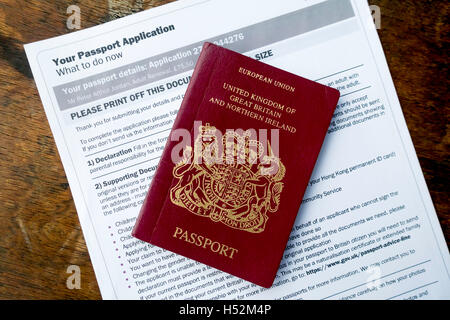 EU United Kingdom Passport with form downloaded as part of the on-line renewal process - Stock Photo