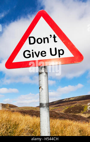 Don't give up persevere carry on continue sign motivational sign signs concept concepts conceptual UK England GB - Stock Photo
