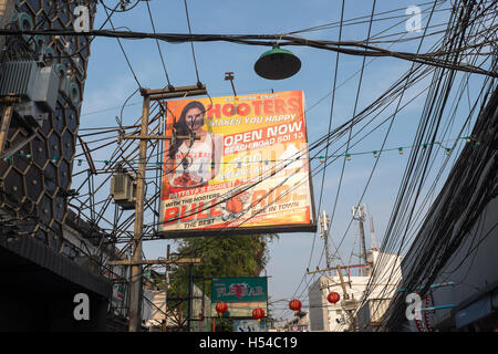 Advert for Hooters Bar in Walking Street Pattaya Thailand - Stock Photo