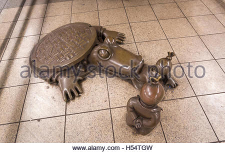 Figures and sewer alligator from bronze sculptures 'Life Underground' by Tom Otterness in 14th Street subway station, - Stock Photo