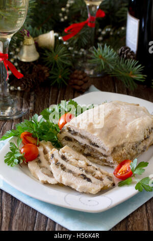 Homemade meatloaf with mushrooms and onions on a festive Christmas table. - Stock Photo