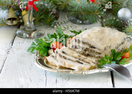 Homemade meat chicken roll with mushrooms, onions and gelatin on the Christmas table. - Stock Photo