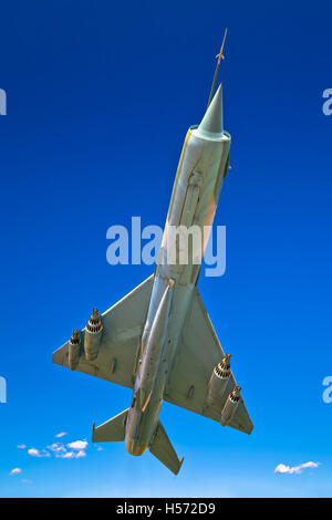 Fighter jet airplane flight under view, clear blue sky background - Stock Photo