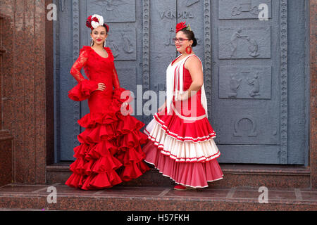 b5a8cd8ac914 ... Two girls in a traditional flamenco dresses during the annual feria in  Fuengirola in Southern Spain
