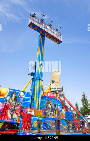 Children amusement rides attractions on closed annual fair. funfair. Carnival, Andalusia, Spain. - Stock Photo