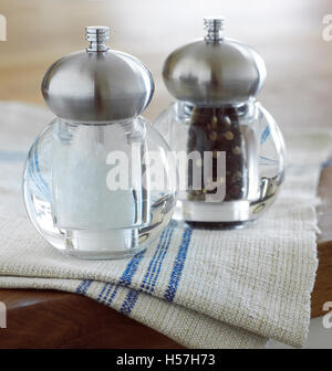 Salt and pepper mills in the kitchen. - Stock Photo