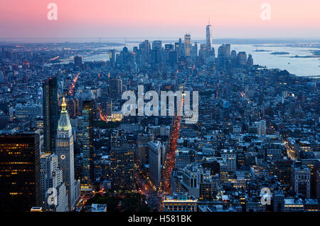 Sunset Manhattan down town aerial view from skycarpenter in warm light - Stock Photo
