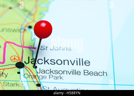 Close up of Jacksonville Florida USA map with red pin and airplane