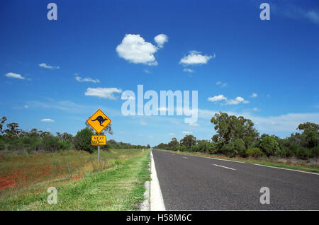 The Mitchell Highway between Bourke and Coolabah, New South Wales, Australia: a roadsign gives a notion of distance - Stock Photo