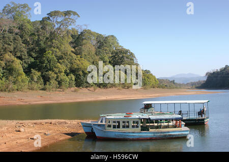 Tourist boats moored at the man-made lake at the centre of the Periyar wildlife sanctuary in Kerala, southern India. - Stock Photo
