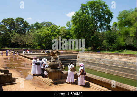 Pilgrims at Kuttam Pokuna, Twin Ponds, Anuradhapura, Sri Lanka - Stock Photo