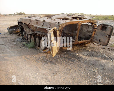 9th July 2003 A burnt out BMP-1 IFV lies abandoned by the roadside, about twenty-five miles north of Baghdad on - Stock Photo