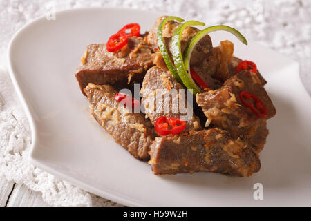 Indonesian Cuisine Beef Rendang Stewed In Coconut Milk With Spices Close Up On A