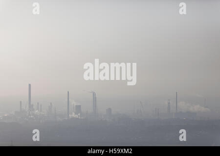 Industrial landscape showing smoking chimneys,pollution rising into the atmosphere,Elton,Cheshire,England,United - Stock Photo