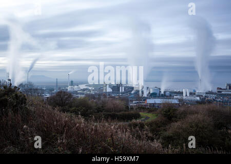 Industrial landscape showing smoking chimneys,pollution rising into the atmosphere,Runcorn,Cheshire,England,United - Stock Photo