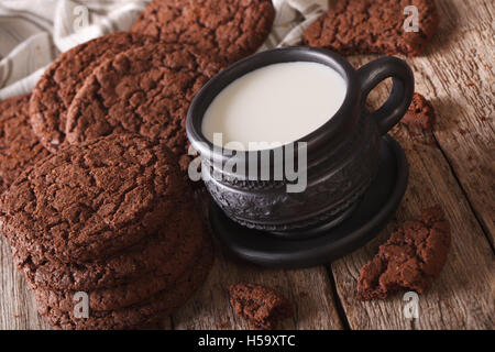 chocolate ginger cookies and milk on the table close-up. horizontal, rustic - Stock Photo