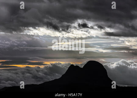 Mountain Suilven silhouetted against sunset with storm clouds, Inverpolly National Nature Reserve, Scottish Highlands, - Stock Photo