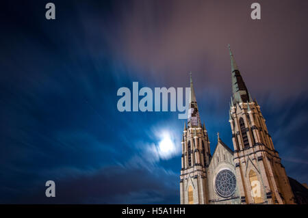 Parish church of Saints Peter and Paul, an abandoned church in Pittsburgh's East Liberty neighborhood, at night - Stock Photo