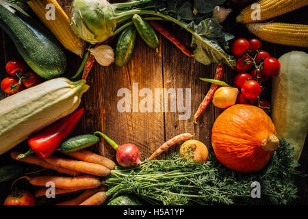 Frame of various vegetables over wooden table with copy space - Stock Photo