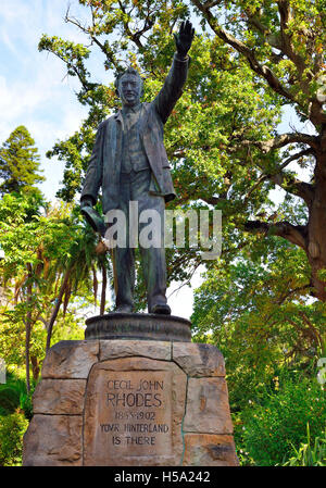 A full statue of Cecil Rhodes African coloniser, wearing a 3-piece suit,standing with his left hand raised and pointing - Stock Photo