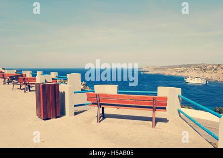 Bench on the waterfront in Santa Teresa di Gallura Harbour - Stock Photo