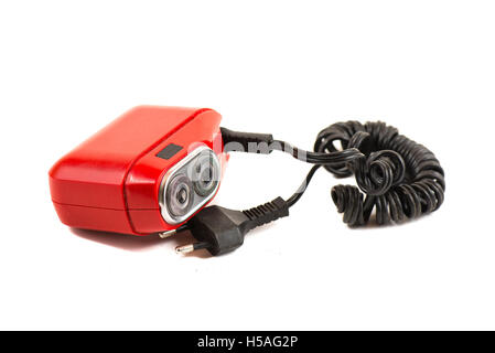 Red vintage electric shaver razor  on white background - Stock Photo