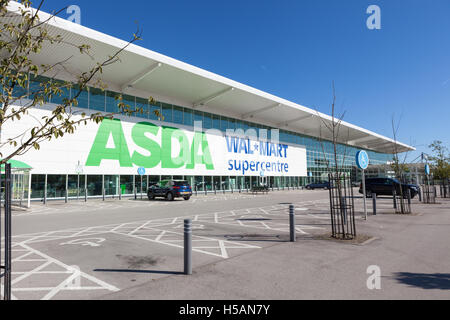 The outside of an Asda Walmart Supercentre on a sunny day. - Stock Photo